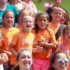 Beverly: Campers from the Peabody Recreation Department react as they watch a few of their counselors go head-to-head with counselors from the Beverly Rec Department, in a mud wrestling match at Lynch Park on Thursday afternoon. David Le/Salem News