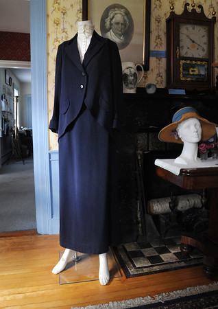 """Peabody:<br /> A sufferage dress is on display at the """"Downton Abbey Style,"""" exhibit showing clothing from the Downtown Abbey era -- World War I to the Jazz Age at the Peabody Historical Society.<br /> Photo by Ken Yuszkus, The Salem News, Friday, August 16, 2013."""