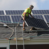 Salem:<br /> Solar panels are installed on Rep. John Keenan's roof by Lloyd Jackson, left, and Charles Brewer.<br /> Photo by Ken Yuszkus, The Salem News, Friday, August 16, 2013.
