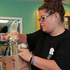 Salem:  Stephanie Roy, an employee at Salem Screamery, a new ice cream shop located at 60 Washington St. in Salem, scoops out a few heaping helpings of ice cream on Thursday afternoon. David Le/Salem News