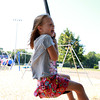 Hamilton: Sadie Armitstead, 5, of Topsfield, lets out a shout of excitement and holds on for dear life as she hurtles across a new swing at Patton Park in Hamilton on Wednesday afternoon. David Le/Salem News