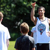 Hamilton: Hamilton native Michael Carter-Williams, the 11th overall pick in the 2013 NBA Draft, explains a drill to young local basketball players during a clinic on Thursday morning behind the Winthrop Elementary School. David Le/Salem News