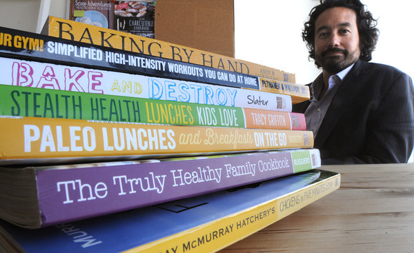 Salem:<br />  William Kiester, who runs a start-up book publishing company with a stack of books his company published.<br /> Photo by Ken Yuszkus, The Salem News, Monday, August 19, 2013.