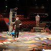 Beverly: Employees at the North Shore Music Theatre work to prepare the stage for the opening night of Cats on Monday afternoon. David Le/Salem News
