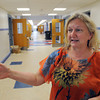 Salem:<br /> Saltonstall's Principal Julie Carter talks about the improvements in the hallway such as the new flooring, new ceiling, and new paint. Saltonstall personnel are moving back into their building on Lafayette Street, after being relocated for two years while the building was renovated.<br /> Photo by Ken Yuszkus, Salem News, Thursday, August 15, 2013.