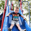 Danvers: Three-year-old Chase Oteri flies down a slide at Plains Park in Danvers on Monday afternoon. David Le/Salem News