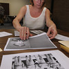 Beverly:<br /> Bonnie Hurd Smith sorts out photos of Judge Buczko when he was in WWII. She came to The Salem News to have the photos scanned for him. North of Boston Media Group is gathering photos of veterans of war for a collector's edition coffee-table book to be be out in December. For information on how to purchase a book, see our ad PAGE ##, or visit WEBSITE.<br /> Photo by Ken Yuszkus, Salem News, Monday, August 12, 2013.
