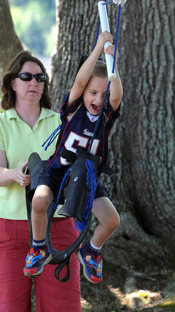 Danvers:<br /> Evan Buonopane, 5, swings on the tire swing with the help from his mother Kathy at the Connors Farm.<br /> Photo by Ken Yuszkus, Salem News, Monday, August 12, 2013.