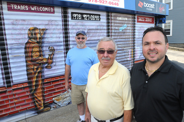 Beverly:<br /> From left, artist Philip Coleman, Tony Linares, Sr., and owner of Marconi Radio, Tony Linares, in front of Marconi Radio with the new mural.<br /> Photo by Ken Yuszkus, The Salem News, Monday, August 19, 2013.