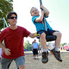 Hamilton: Maxwell Armitstead, 3 1/2, of Topsfield, gets a push from his father Mark, on a new swing at Patton Park in Hamilton on Wednesday afternoon. David Le/Salem News