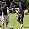 "Middleton:<br /> Boston Bruins players Dan Paille, left, and Tuukka Rask talk before the start of the fourth annual ""Putts and Punches for Parkinson's"" Golf Tournament held at the Ferncroft Country Club. <br /> Photo by Ken Yuszkus, Salem News, Monday, August 12, 2013."