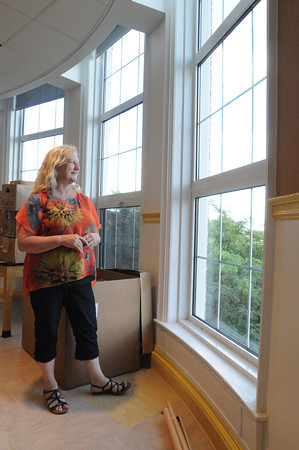 Salem:<br /> Saltonstall's Principal Julie Carter looks out toward the ocean through the new windows of the second floor science room. Saltonstall personnel are moving back into their building on Lafayette Street, after being relocated for two years while the building was renovated.<br /> Photo by Ken Yuszkus, Salem News, Thursday, August 15, 2013.