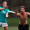 Beverly: Emma Titus, 19, and Nathan Dykes, 22, both of Salem, fight for position as they try and catch the frisbee while playing pickup ultimate at Lynch Park on Monday evening. David Le/Salem News