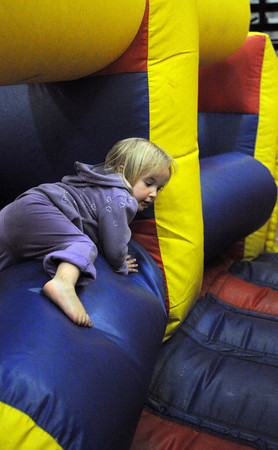 Salem:<br /> Lily Freitas crawls through the inflatable obstacle course during Kids Night at the Salem High School gym. Kids Night was part of Salem's annual Heritage Days.<br /> Photo by Ken Yuszkus, Salem News, Friday, August 9, 2013.