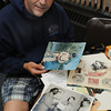 Beverly:<br /> Carl McKay brought in photos of his father, who served in Vietnam, to The Salem News to have the photos scanned. North of Boston Media Group is gathering photos of veterans of war for a collector's edition coffee-table book to be be out in December. For information on how to purchase a book, see our ad PAGE ##, or visit WEBSITE.<br /> Photo by Ken Yuszkus, Salem News, Monday, August 12, 2013.
