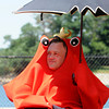 Beverly:<br /> Homecoming lobster Kenneth Glover is sitting under an umbrella at the annual Beverly Homecoming Lobster Festival held at Lynch Park. He is with the homecoming committee.<br /> Photo by Ken Yuszkus, Salem News , Wednesday, August 7, 2013.