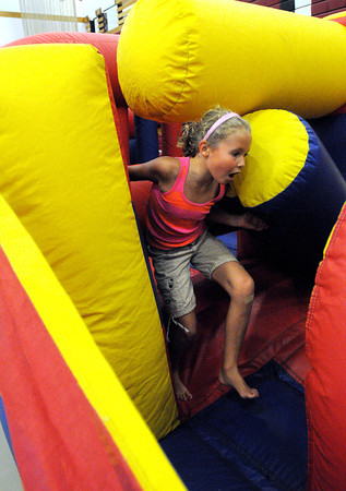 Salem:<br /> Aly Boucher makes her way through the inflatable obstacle course during Kids Night at the Salem High School gym. Kids Night was part of Salem's annual Heritage Days.<br /> Photo by Ken Yuszkus, Salem News, Friday, August 9, 2013.
