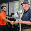 Boxford:<br /> First place winner Josh Salah, left, is congratulated by golf pro John O' Connor as he presents the prize for 1st place at the North Shore Amateur Golf Tournament final round held at Far Corner Golf Club.<br /> Photo by Ken Yuszkus, Salem News, Wednesday, August 14, 2013.