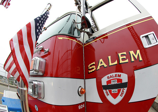 Peabody: The Salem Fire Department Ladder 1 truck displays the customary black band across it's emblem on the drivers side door to remember former Salem firefighter Kevin O'Boyle. David Le/Salem News