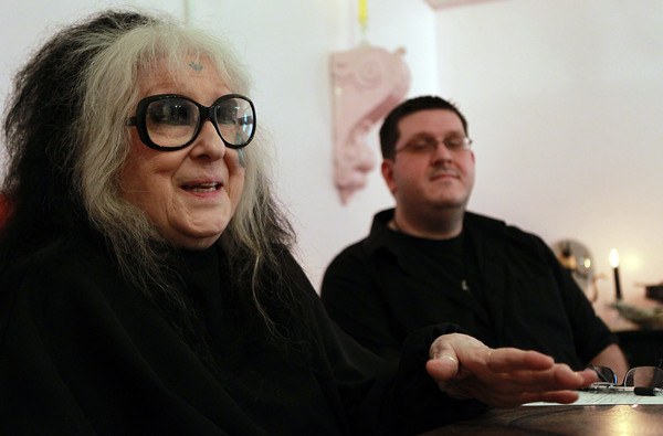 Salem: Laurie Cabot, the official Witch of the City of Salem, talks about her partnership with the new Enchanted Bookstore on Pickering Wharf, as shop owner Chris Levasseur listens. David Le/Salem News