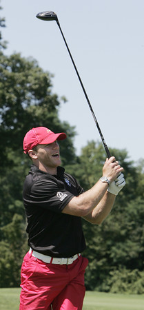 "Middleton:<br /> Boston Bruins player Shawn Thornton lights up with a smile as he hits off the 1st tee during the fourth annual ""Putts and Punches for Parkinson's"" Golf Tournament held at the Ferncroft Country Club. <br /> Photo by Ken Yuszkus, Salem News, Monday, August 12, 2013."