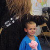 Salem:<br /> Nicholas Warren, 4, poses for a photo with Chewbacca at the Moon Landing Party held at the Salem Public Library on Wednesday afternoon.<br /> Photo by Ken Yuszkus, The Salem News, Wednesday, August 21, 2013.