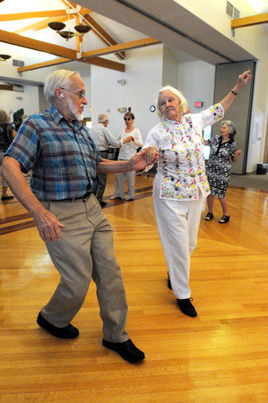 Beverly:<br /> Bob Taft and Nanine Rhinelander dance during the Big Band dance at the Beverly Senior Center hosted by Council on Aging which was part of Beverly Homecoming.<br /> Photo by Ken Yuszkus, Salem News , Tuesday, August 6, 2013.