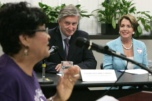 """Beverly:<br /> The Speaker of the U.S. House of Representatives and current House Democratic Leader Nancy Pelosi and Congressman John Tierney listen to Ana Perdomo, left, of Lynn speak at the Cummings Center during a discussion on the newly-announced Economic Agenda for Women and Families, """"When Women Succeed, America Succeeds.""""<br /> Photo by Ken Yuszkus, The Salem News, Friday, August 23, 2013."""