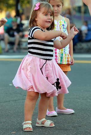 Danvers: Erin Witham, 3 1/2, of Gloucester, dances in the middle of Danvers Square during Oldies Night on Wednesday. David Le/Salem News