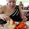Beverly:<br /> Lucia Coffey of Beverly dunks a lobster tail into some warm butter while dining on her lobster dinner at the annual Beverly Homecoming Lobster Festival held at Lynch Park.<br /> Photo by Ken Yuszkus, Salem News , Wednesday, August 7, 2013.