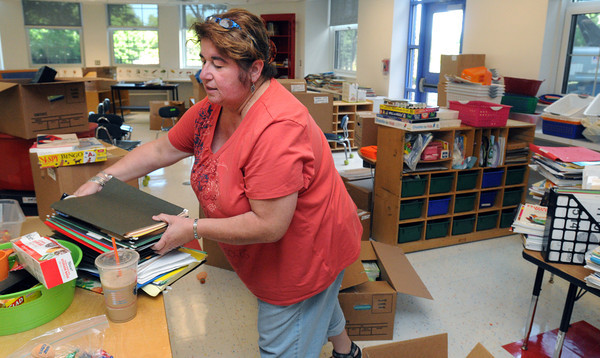 Salem:<br /> Saltonstall's kindergarten teacher Cindy Hatcher is unpacking and setting up her room for the opening day of school. Saltonstall School personnel are moving back into their building on Lafayette Street, after being relocated for two years while the building was renovated.<br /> Photo by Ken Yuszkus, Salem News, Thursday, August 15, 2013.