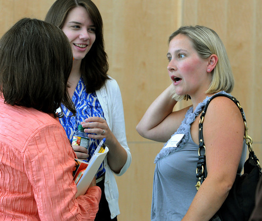 Danvers:<br /> From left, mentor SPED teacher Ellen Bresner speaks with two new teachers, Hannah Lombard and Brynn Sweeney at the new teacher orientation lunch held at Danvers High School.<br /> Photo by Ken Yuszkus, The Salem News, Thursday, August 22, 2013.