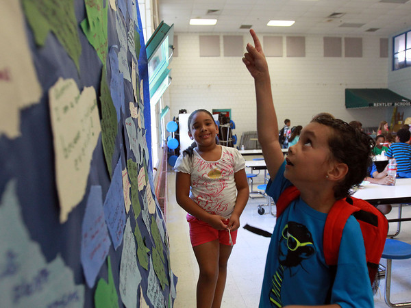 Salem: Seven-year-old Isiah Muriel, points to his learning goal posted on the Wave of Learning at the Bentley School on Thursday morning. Salem State University and the Bentley School have collaborated to run a summer program for kids focused on Science and Literacy. David Le/Salem News