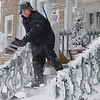 Salem: Alex Fraczek shovels his snow encrusted front porch and stairs during the snowstorm on Monday morning.<br /> Photo by Ken Yuszkus/Salem,  News, Monday,  December 27, 2010.