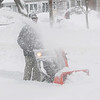 Beverly: Bill Hansen uses his snowblower to remove the snow on the sidewalk in front of his home during the snowstorm on Monday morning.<br /> Photo by Ken Yuszkus/Salem,  News, Monday,  December 27, 2010.
