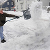 Salem: Vince Swiniuch throws a shovel full of snow as he shovels his driveway during the snowstorm on Monday morning.<br /> Photo by Ken Yuszkus/Salem,  News, Monday,  December 27, 2010.