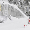 Beverly: Bill Hansen's snowblower throws a long stream of snow as he removes the snow on the sidewalk in front of his home during the snowstorm on Monday morning. Photo by Ken Yuszkus/Salem,  News, Monday,  December 27, 2010.