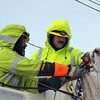 Marblehead: Lineman Paul Camerda and Joe Walker work to restore power on Beacon Street in Marblehead after a fallen tree wiped out four utility poles. Photo by Alan Burke/Salem,  News, Monday,  December 27, 2010.