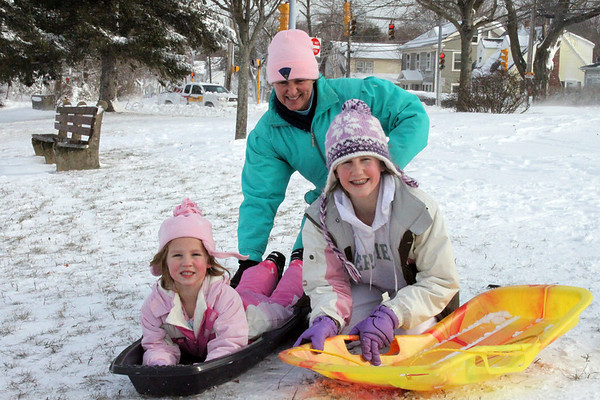 Marblehead: Donna Horgan and daughters Taylor (left) and Erin take advantage of the snow to go sledding at Gatchell Park. Photo by Alan Burke/Salem,  News, Monday,  December 27, 2010.
