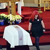 At the funeral at St. James Church in Salem Massachusetts for U.S. Sgt. James Ayube Jr. of Salem, Ashleigh Ayube, 17, James' sister, walks past the casket of after reading a passage from the Bible.  She later gave a eulogy.   photo by Mark Teiwes / Salem News   photo by Mark Teiwes / Salem News