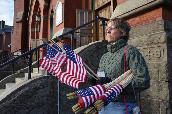 Patri Serino of Salem volunteered with Boy Scout troop 24 to hand out flags    photo by Mark Teiwes / Salem News