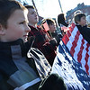 From left, Casey Williamson, 10 and his brother Eamon, 12, John Cataldo, 12, and his brother Christopher, 10, all from Salem hold flags along the procession route to show their support.   photo by Mark Teiwes / Salem News