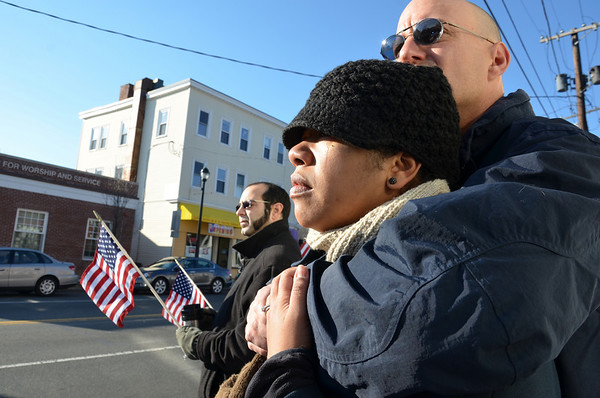 Janet and Douglas Frye watch the procession go by.  photo by Mark Teiwes / Salem News
