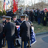 Members of the Massachusetts Army National Guard 54th Volunteer Regiment carry the casket at the burial of U.S. Sgt. James Ayube Jr. of Salem Massachusetts, a combat medic killed last week in Afghanistan.   Ayube's family stands at right at the Harmony Grove Cemetery.   photo by Mark Teiwes / Salem News