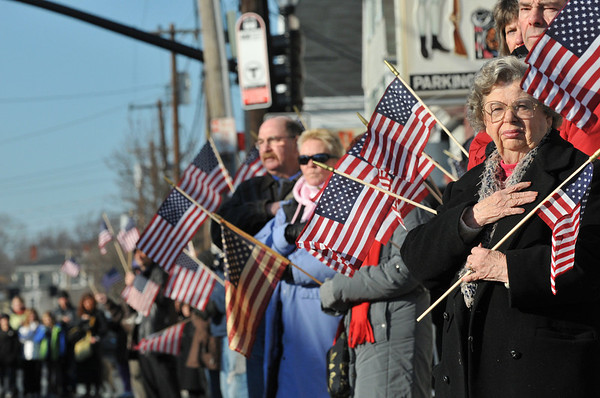 Irene Zielski of Peabody watches as the funeral motorcade passes. photo by Mark Teiwes / Salem News