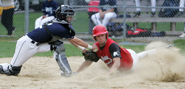 Masconomet's Chris Splinter touches home plate before the tag by Pingree's Chase Goodwin during yesterday's game held at Pingree. Photo by Deborah Parker/April 12, 2010