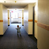 Christopher Evans Jr, 1, runs down the hall of Motel 6 where his family had been living since August. Photo by Deborah Parker/December 22, 2009