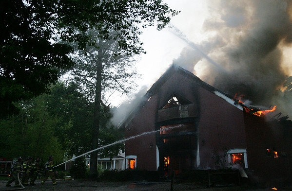 Firefighters work to extinguish a fire at 775 Bay Road in Hamilton. Photo by Deborah Parker/May 24, 2010