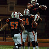 Lynn:  Beverly's Blake Sullivan is hoisted by teammates after he scored the team's touchdown fifth touchdown in the third quarter . Photo by Mark Teiwes / Salem News. Nov. 30, 2010.