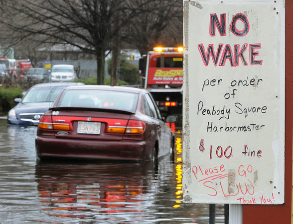 The sign tells the story on Railroad Avenue in Peabody, where two abandoned cars were stranded in the high water created by the heavy rainfall. Photo by Ken Yuszkus/Salem News, Wednesday, March 31, 2010.